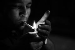The good boy with a bad habit.... (N A Y E E M) Tags: nightphotography light party night availablelight cigarette smoke bangladesh drunkphotography woodlandpark chittagong communitycenter rafiq canonef50mmf14usm bwconversion canoneos5d nayeemkalam