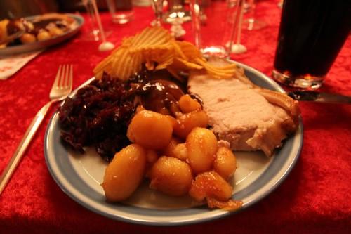 It's heavy. It's delicious. It's Danish. It's a classic. Flæskesteg med rødkål, brunede kartofler, hvide kartofler og chips...Bon appetit!
