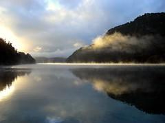 Flames on the water (Magryciak) Tags: newzealand mist lake weather sunrise dawn kayak 2010 intova waikaremoana