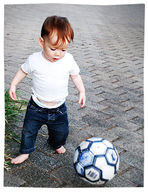 Liam at 1 year - Kicking a ball