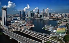 Marina Bay L_9210 (Andrew JK Tan) Tags: park bridge skyline architecture youth marina bay singapore skyscrapers platform floating sigma casino mice esplanade helix olympic sands financial 1224mm bayfront youtholympicpark