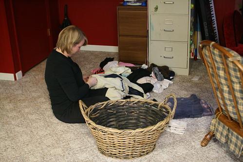 Rachel folding laundry