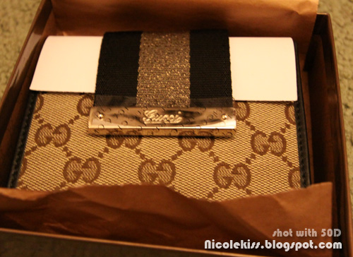 Gucci cruise wallet GG fabric