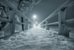Ghost Bridge (Latyrx) Tags: bridge light shadow sea mist snow man black ice nature monochrome fog mystery night photoshop suomi finland photography coast photo helsinki nikon long exposure frost mood view angle graphic low ghost stock perspective sigma atmosphere frosty monochromatic together shore blended mysterious finnish 1020mm sell toned 2009 kaivopuisto mikko 2010 resize uunisaari latyrx d90 3exp nikond90 mikkolagerstedt