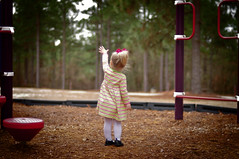 """""""You don't have to be a fantastic hero to do certain things - to compete. You can be just an ordinary chap, sufficiently motivated to reach challenging goals."""" (Laura Fulmer) Tags: winter light baby playground georgia 50mm hands child reaching january illumination naturallight reach 50mmf14 2yearsold edmundhillary nikond300"""