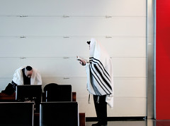 Rabbi (eMMa_bOOm) Tags: red people men wall airport ditch chairs zurich jewish curl rabbi dignity zurichairport prayers rituals scarfs thesewer ditch2 artofimages ditch3 ditch6 ditch8 ditch9 ditch10 ditch4 ditch5 ditch7