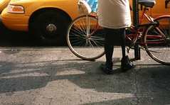 nice boots! (justinsdisgustin) Tags: street camera new york city film 35mm photography punk boots kodak leg olympus bull xa2 hardcore limb punky amputee amputated legless nyhc 400vc