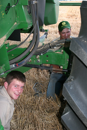 Two John Deere Reps work on fixing Callums GPS.