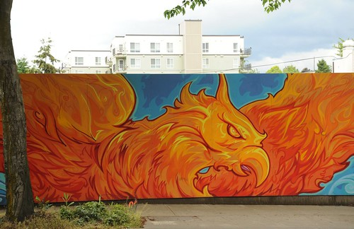 From the ashes arises the Phoenix, mural covering the location of the arson which burned out an old building with several businesses, Greenwood, Seattle, Washington, USA by Wonderlane