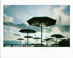 .. (Js) Tags: sky sunlight toronto backlight clouds fuji instant epson backlit umbrellas instax ligh 210 v700 htopark roidweek2009