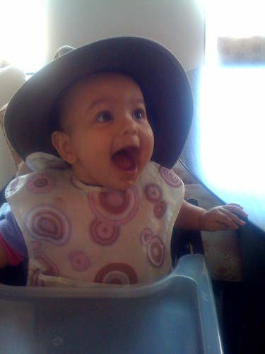 Laila wearing Salim's hat