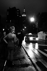 Rainy Night in NYC (Airicsson) Tags: park street new york city nyc light urban blackandwhite bw usa white ny newyork black building halloween girl youth night contrast america dark square island lumix lights us high noir state manhattan cab taxi young teenagers nb parade panasonic teen madison age empire teenager streetphoto avenue et blanc fifth teenage streetshot contrasted blackwhitephotos lx3 platinumheartaward