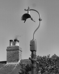 The Electric Street Lighting Apparatus Co Ltd (Lady Wulfrun) Tags: november roof chimney rooftop streetlight rooftops smoke smoking 1950s coal 2009 nottinghamshire oldfashioned tiled streetlighting directional notts coalman selston esla 2way openfires bimulti electricstreetlightingapparatus