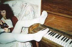 holga piano tights (Adele M. Reed) Tags: party white fun holga piano tights loz kodak200 nikonl35af