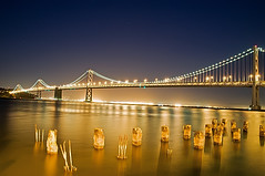Walking The Embarcadero (Explore) (Scott Barlow) Tags: california city bridge building ferry night lens lights oakland bay pier twilight nikon san francisco raw nef exercise path financialdistrict explore baybridge embarcadero bayarea handheld tamron jog southbeach 1933 interstate80 d300 americanbridgecompany tollbridge 5photosaday nothdr impressedbeauty charleshpurcell thejamessunny jimrolphbridge af1750mmf28spxrdiiivc