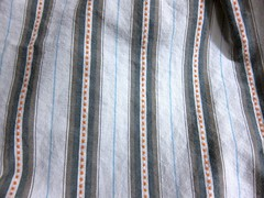 White and orange striped men's shirting