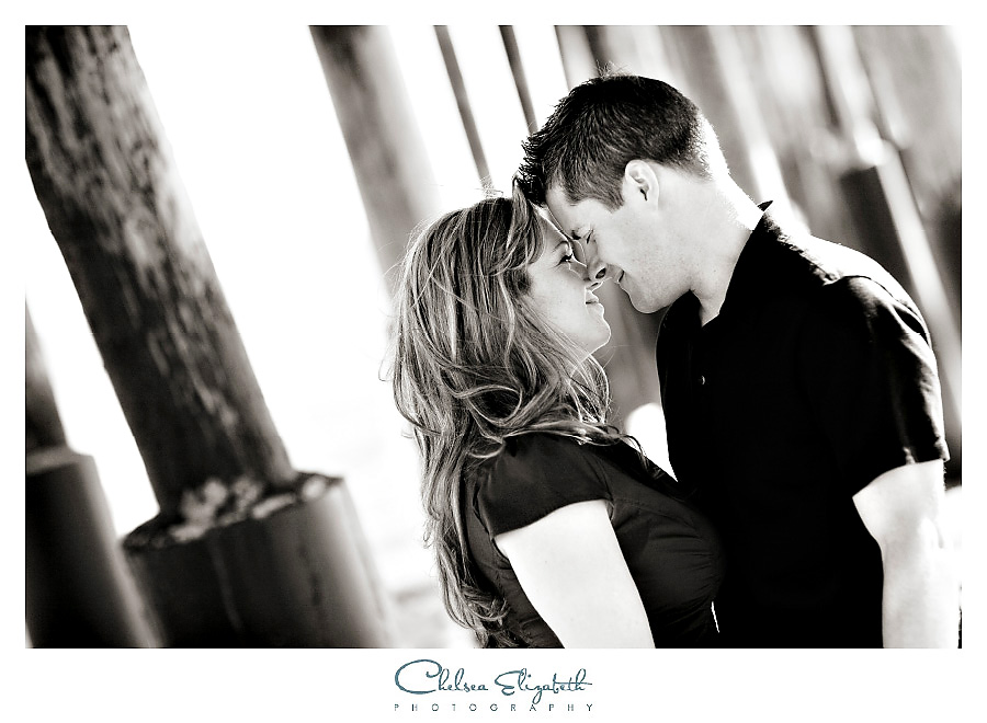 Black and white ventura pier pilings engagement session