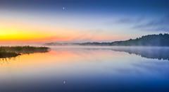 Two moons enhanced (Mikko Vuorinen) Tags: sunset sea summer sky moon mist seascape reflection nature fog night sunrise reflections finland landscape hdr mikko bestshotoftheday vuorinen flickraward allaboutsun flickraward5 flickrawardgallery