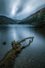 Upper lake in Glendalough - Wicklow, Ireland - Landscape photography (Giuseppe Milo (www.pixael.com)) Tags: layered calm print nature reflection lake orange trees mysterious tree photography fuji sky water winter wallart outdoors natural photo tranquil canvas prints landscape sunset skyline yellow european mountains depth outdoor landscapes outside fujifilm rocks fineart sun blue photograph scenery beautiful travel forest peaceful view xpro2 green clouds europe fujixpro2 mountain onsale