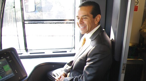 Mayor Antonio Villaraigosa rides in the cab of the Gold Line train as it makes its way to East L.A. Civic Center.