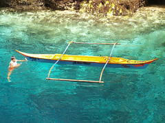 Hinatuan's Enchanted River (SweetCaroline) Tags: blue nature boat fisherman olympus pk bluewaters sweetcaroline boatman surigaodelsur hinatuan garbongbisaya enchantedriver