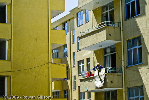 An Ethiopian woman beats the dust out of her rugs during morning cleaning in Addis Ababa.