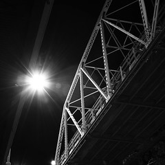 Underbelly (andy keels) Tags: bridge blackandwhite monochrome night iron streetlamp geometry steel structure nightlife 1785mm truss canonrebelxti