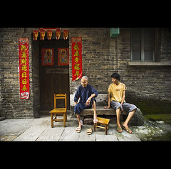 daily talk beside ghost catchers - China ( Tatiana Cardeal) Tags: guangzhou china door red asia village chinese guangdong gateway banners canton canto chatang