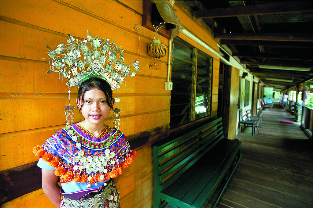 Cultural diversity.  Iban girl standing in longhouse. Brunei. Photo courtesy Brunei Tourism.