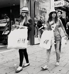 Owner of a lonely heart (Ian Brumpton) Tags: street uk england people urban blackandwhite bw london blancoynegro blackwhite noiretblanc candid streetphotography monotone monochromatic sidewalk oxfordstreet streetscenes biancoenero oxfordcircus decisivemoment steppingout westendgirls modelbehaviour londonstreetphotography ownerofalonelyheart scattidistrada strollingwithstyle blackwhiteemotions aimlessstrolling blackwhiteheartbeats