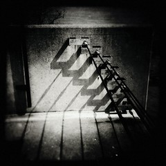 - (noir imp) Tags: bw metal entropy wire industrial shadows decay cement cables iphone