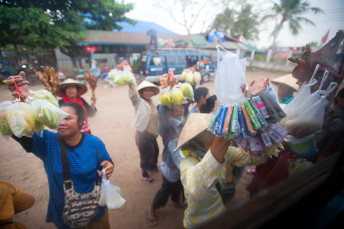 Vendors at a bus stop in Savannakhet, Laos