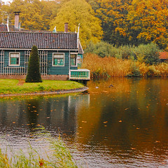 That little house by the lake (mendhak) Tags: autumn wallpaper house lake reflection fall colors leaves square geotagged crop geo:lat=5201161670 geo:lon=591032670 mendhakwallpaper