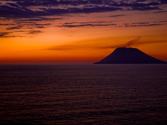 Volcanic Sunset... (Chris H#) Tags: sunset sea orange water clouds volcano mediterranean calm smoking stromboli activevolcano volcanicsunset samsungs800
