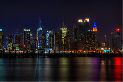 Empire State Building Midtown Manhattan View (©eophir photography) Tags: nyc newyorkcity longexposure nightphotography canon buildings reflections boats lights newjersey glow nightlights view nightscape piers noflash illuminated celebration reflected ups timessquare citylights jersey brightlights hudsonriver chryslerbuilding westsidehighway amateur canoneos nocturne hdr highdynamicrange whotel afterdark urbanlandscape weehawken 30d airspacemuseum hudsoncounty portimperial awesomeshot photomatix canon30d northernnewjersey throughmyglasseye platinumphoto theunforgettablepictures theintrepidsea midtownmanhattanview madisonsquaregirlsboysclub girlsboysclubofamerica