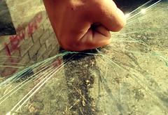 Escapist (Juan Carlos Aristimuño) Tags: hit smash brokenglass destroyer reflejo punching punch cristal vidrio breaking destroy puño rompiendo destructor veneflickr punchingglass