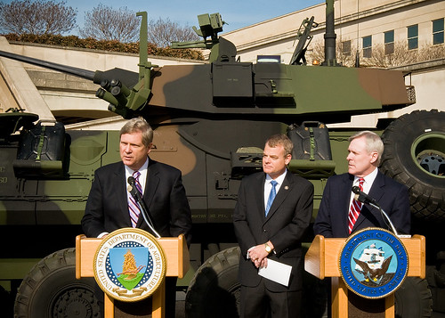Secretary Vilsack, Congressman McIntire and Secretary Mabus answer reporters questions while standing in front of a light assault vehicle of the type capable to accommodate fuel from renewable sources.