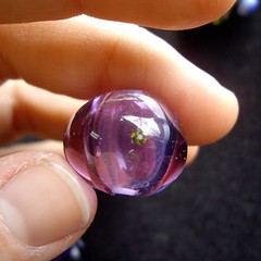 I made a hollow bead! And it has a cubic zirconium embedded on it. Yay for improving skills.