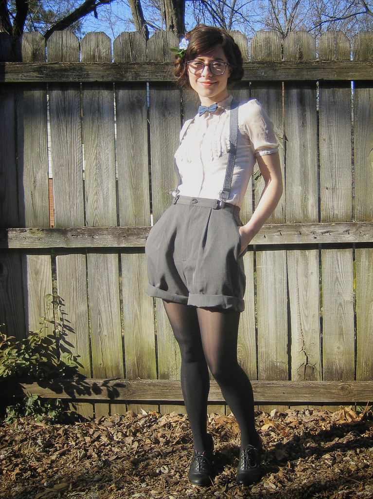 some handmade shorts, man glasses, and a bow tie
