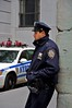 police officer in Wall street (Clément Livolsi) Tags: park street new york city bridge building apple statue wall square liberty store mac cops view state time manhattan south north central broadway nypd center panoramic donald rockefeller brooklin 180° 360° emire