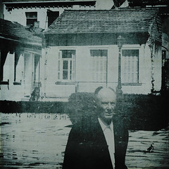 the bird and the man (Stathis Stavrianos (Stathis_1980)) Tags: old blue houses windows bw man building bird texture 6x6 vintage grunge scratch squared textured stathis1980