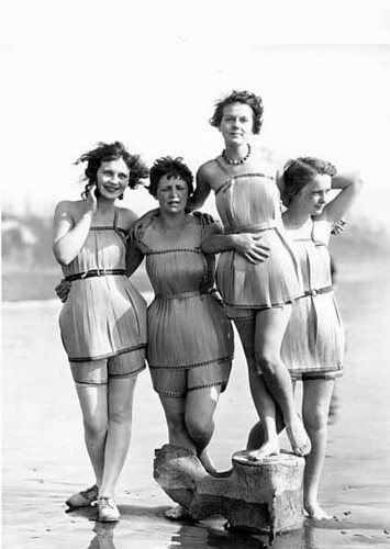 """Spruce Girls"" on beach wearing spruce wood veneer bathing suits during ""Wood Week"" to promote products of the Gray Harbor lumber industry, Hoquiam, Washington"