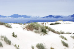 White Sands After the Storm - 6/16 (jolee-mer) Tags: whitesandsnationalmonument sand white hills hilly mountains peaks clouds brush desert plants yucca stormy sky newmexico blue otherworldliness vista view landscape pale cool low dunes gypsum