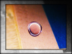 Water droplet on glass (piyushthacker) Tags: morning macro art water colors car closeup exposure bright finepix imagine droplet fujifilm windscreen surroundings s5700 04112009