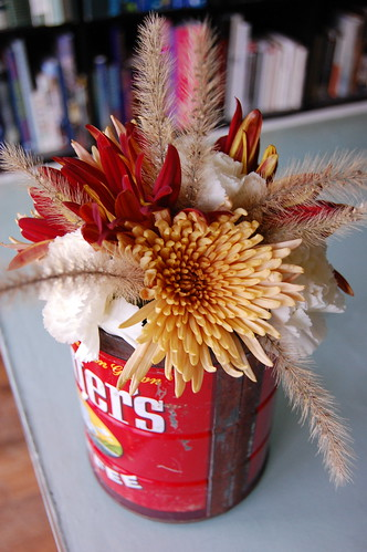 flowers in a coffee can