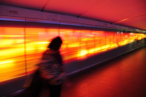Glowing orange/gold walkway under Railway Square, Sydney - slow exposure