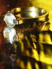 Ring and Yellow Reflections (#1074) (protophotogsl) Tags: white macro reflection glass yellow metal gold metallic engagementring ring diamond diamondring protophotogsl mygearandme~4awardthread heartawards~4starterthread img9043adjusted