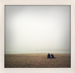 Lonely Couple (VoodooDahl) Tags: ocean light mist love beach water fog couple pacific sunless iphone iluviphone shakeitphoto
