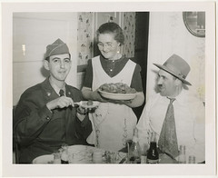 Pfc. Morton Gutstadt tried out the gefilte fish of Mrs. Dave Starr..., 1952 (Center for Jewish History, NYC) Tags: holidays jewish jews passover denvercolorado pesach servicemen jewishsoldiers americanjewishhistoricalsociety ritesandcustoms nationaljewishwelfareboardrecords albertocorwin