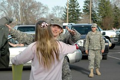 Outside BHS, Spc. Lori Vermillion receives a hug upon her return to Burns on April 18. (Photo by LAUREN BROWN)